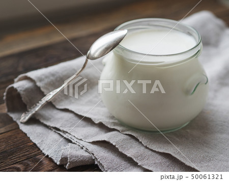 Natural homemade yogurt in a glass jar. Healthy 50061321