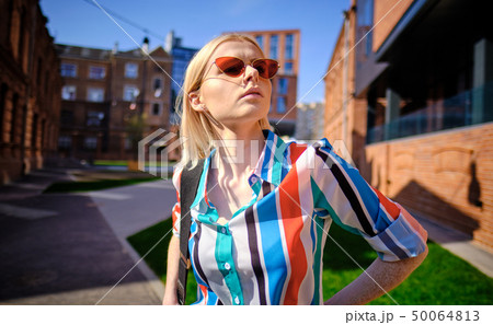 Fashionable girl in a summer shirt on the city 50064813