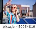 女性 フォン 電話の写真 50064819