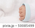 Newborn baby hand closeup view on white cloth 50085499