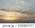 Sunrise with dramatic clouds at sky light beams 50085557