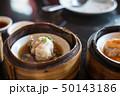 Chinese dim sum in a bamboo steamer box 50143186