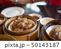 Chinese dim sum in a bamboo steamer box 50143187
