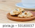 Cashew cookies on wooden desktop with copy space 50160037