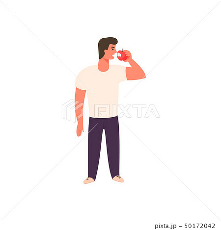Athletic young man is eating an apple 50172042