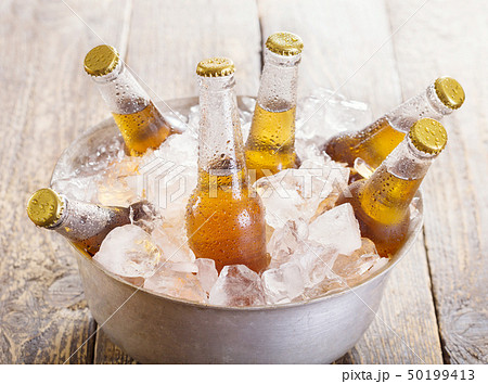 cold bottles of beer in bucket with ice 50199413