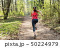 Fitness woman run in spring sunny forest 50224979
