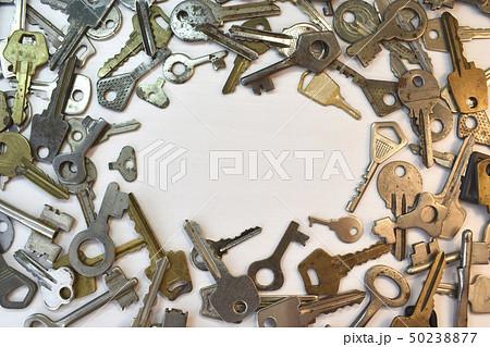 Old vintage various keys pattern. Antique metal gold bronze silver color different clue for padlock 50238877