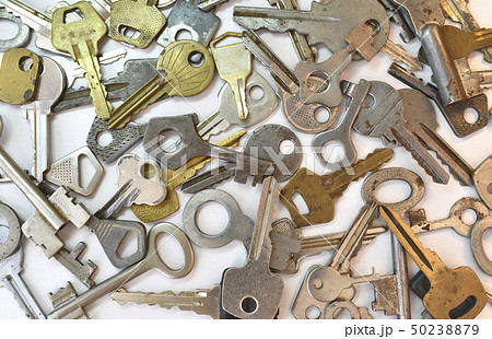 Old vintage various keys pattern. Antique metal gold bronze silver color different clue for padlock 50238879