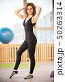 Young slim woman in glasses in the fitness studio 50263314