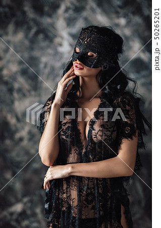 portrait of sexy beautiful woman in lace lingerie and carnival mask 50265201