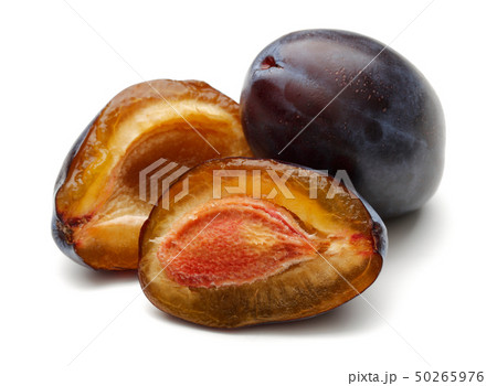 Whole and half Damson plums isolated on white 50265976