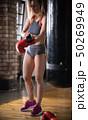 A tired woman boxer drops down boxer gloves 50269949