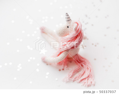 Cute fairy unicorn with a pink mane and a tail 50337037