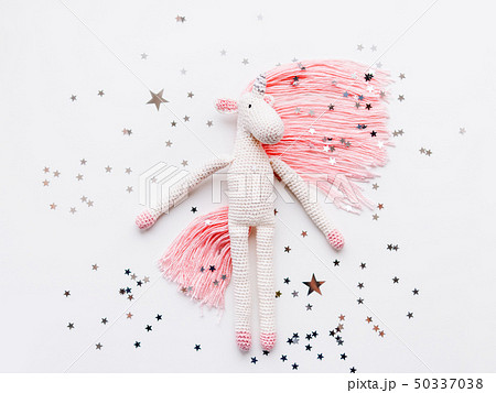 Cute fairy unicorn with a pink mane and a tail 50337038