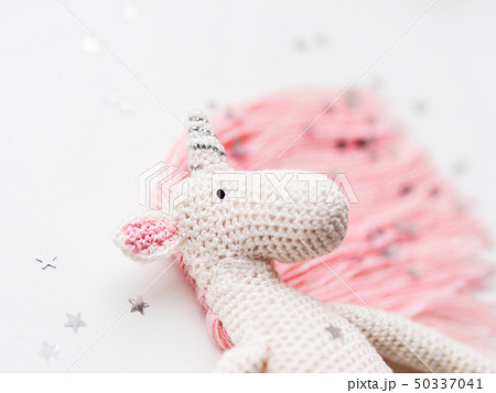 Cute fairy unicorn with a pink mane and a tail 50337041