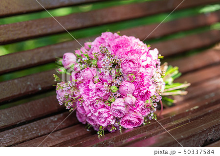 Bridal bouquet with pink and lilac roses. 50337584