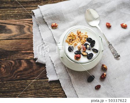 Natural homemade yogurt in a glass jar. Muesli 50337622