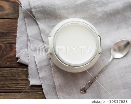 Natural homemade yogurt in a glass jar. Healthy 50337623