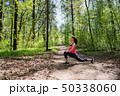 Fitness woman doing leg stretching in summer forest 50338060