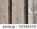 fence of rough boards outdoor closeup 50386358