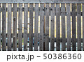 fence of rough boards outdoor 50386360