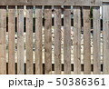 fence of rough boards outdoor 50386361
