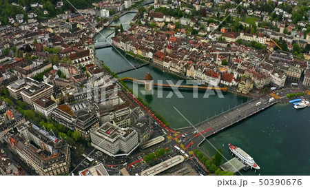 Aerial view of Kapellbrucke or Chapel Bridge within the cityscape of Lucerne, Switzerland 50390676