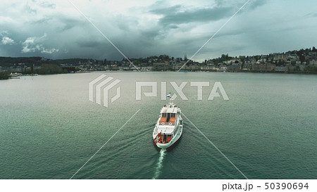 Aerial view of a ship with waving Swiss flag heading for Lucerne on the lake, Switzerland 50390694