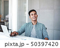 Happy Young Businessman Working on Computer Laptop 50397420