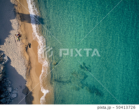 Beautiful beach with family top view shot 50413726