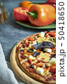 Slice of hot pizza large cheese lunch or dinner crust seafood meat topping sauce. with bell pepper 50418650