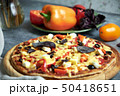 Slice of hot pizza large cheese lunch or dinner crust seafood meat topping sauce. with bell pepper 50418651
