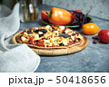 Slice of hot pizza large cheese lunch or dinner crust seafood meat topping sauce. with bell pepper 50418656