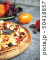 Slice of hot pizza large cheese lunch or dinner crust seafood meat topping sauce. with bell pepper 50418657