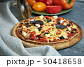 Slice of hot pizza large cheese lunch or dinner crust seafood meat topping sauce. with bell pepper 50418658