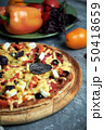 Slice of hot pizza large cheese lunch or dinner crust seafood meat topping sauce. with bell pepper 50418659