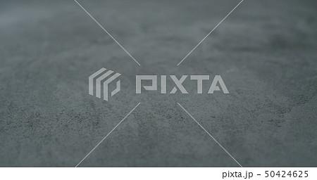 decorative dark concrete background with shallow focus 50424625