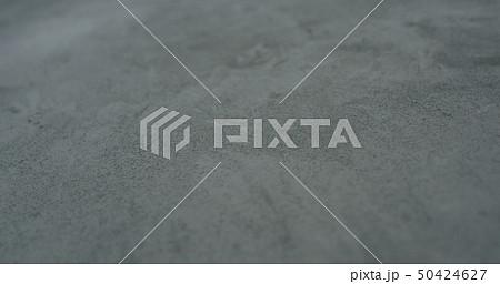 decorative dark concrete background with shallow focus 50424627