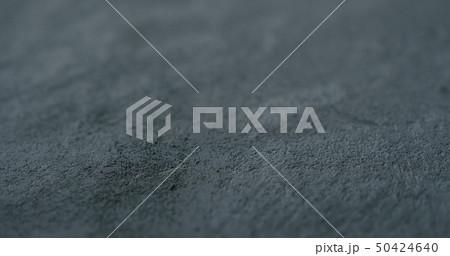 decorative dark concrete background with shallow focus 50424640