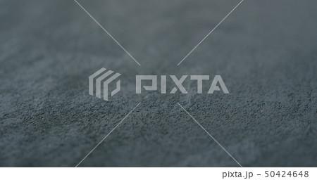 decorative dark concrete background with shallow focus 50424648