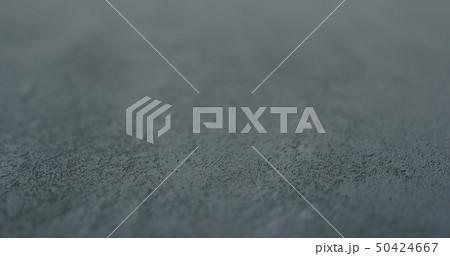 decorative dark concrete background with shallow focus 50424667