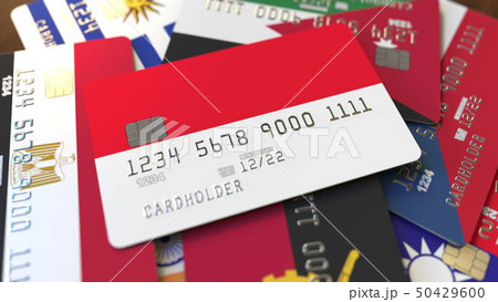 Many credit cards with different flags, emphasized bank card with flag of Indonesia. 3D rendering 50429600