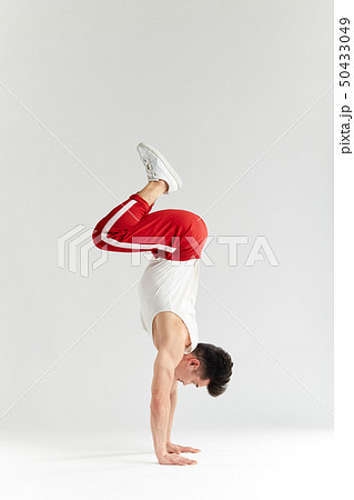 Korean dancer executes basic freezes of downrock brea dance isolated on white 50433049