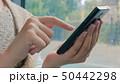 Woman using smartphone 50442298