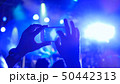 Hand silhouette recording video of live music concert with smartphone 50442313