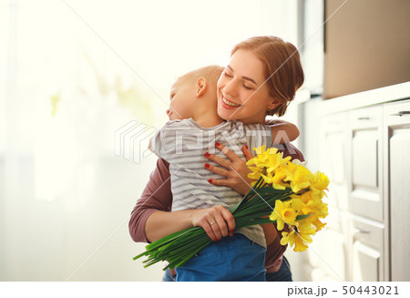 happy mother's day! child son gives flowersfor  50443021