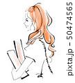 本を抱える女性 50474565