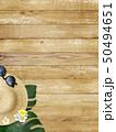 背景-海-夏-ビーチ-ウッドデッキ-モンステラ-プルメリア-麦わら帽子-サングラス 50494651
