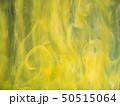 Acrylic yellow smoke swirling under water 50515064